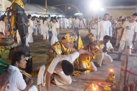 Trang, Thailand - October 14, 2018: Chinese God Monkey King spiritual medium pray for god at Tai-Sia-Hood-jow Trang shrine during vegetarian festival.