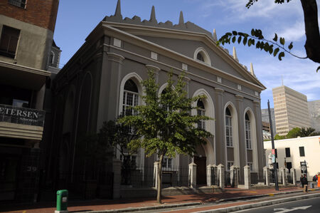damaging: Groote Kerk  translation  Great Church  in the main street of Cape Town, South Africa, instead of damaging history, developers built the adjacent building around it  Editorial