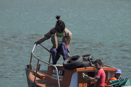 Subsistance fishermen heading out to sea for daily catch from Kalk Bay Harbour Cape Town South Africa