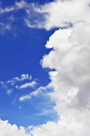 Beautiful cloudscape on bright blue sky as background photo