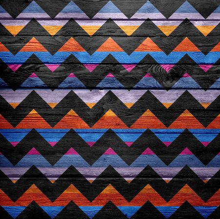 Colorful chevron pattern texture background on wood Stock Photo