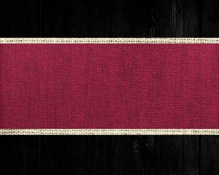 scarlet: Dark scarlet jute canvas banner textured with dark wood background