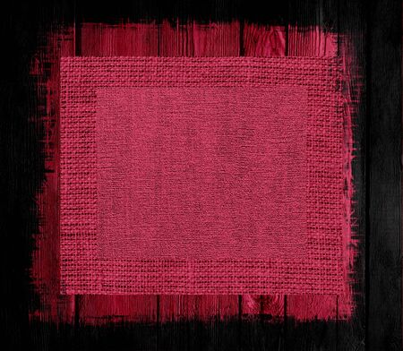 maroon: maroon red canvas textured on wood background