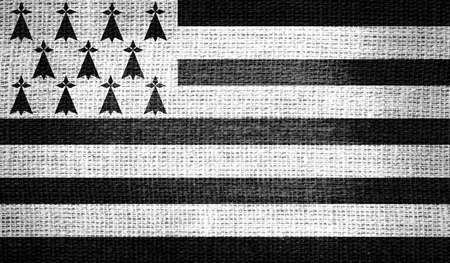 brittany: Brittany flag on burlap fabric Stock Photo