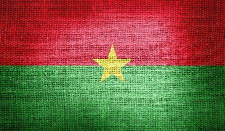 burkina faso: Burkina Faso flag on burlap fabric Stock Photo