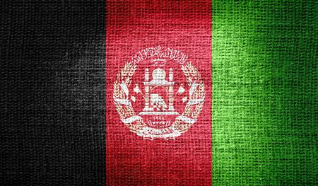 afghanistan flag: Afghanistan flag on burlap fabric Stock Photo