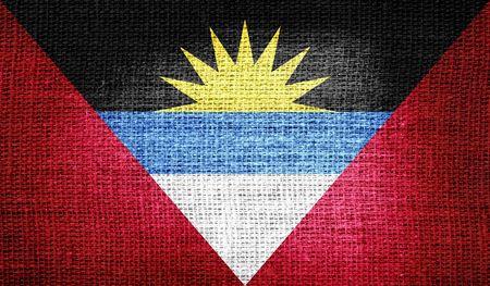 antigua and barbuda: Antigua and Barbuda flag on burlap fabric Stock Photo
