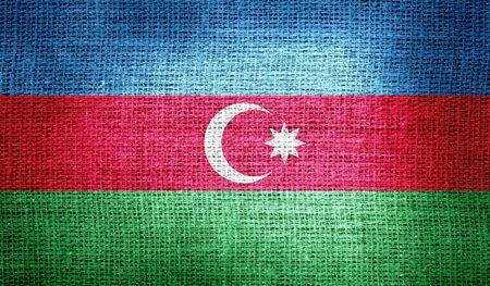 Azerbaijan flag on burlap fabric photo