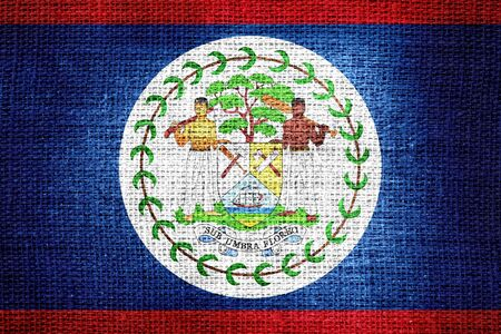 belize: Flag of Belize on burlap fabric