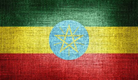 ethiopia abstract: Ethiopia flag on burlap fabric