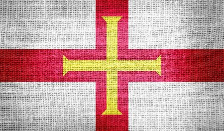 guernsey: Guernsey flag on burlap fabric