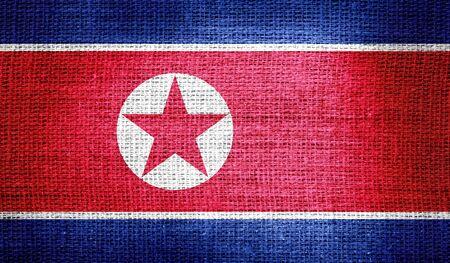 korea flag: North Korea flag on burlap fabric