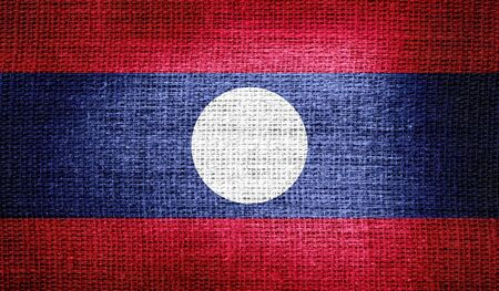 laos: Laos flag on burlap fabric Stock Photo