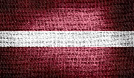 latvia: Latvia flag on burlap fabric Stock Photo