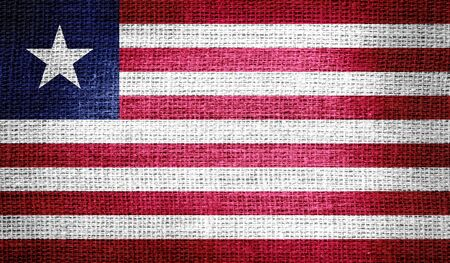 Liberia flag on burlap fabric photo