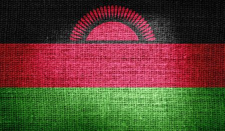 correctly: Malawi flag on burlap fabric Stock Photo