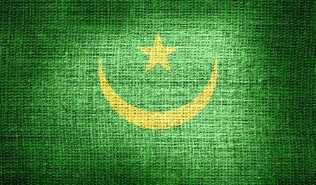 northwest africa: Mauritania flag on burlap fabric Stock Photo