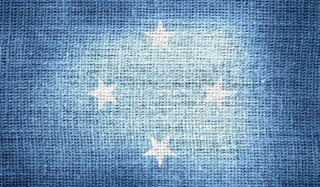 federated: Flag of Federated States of Micronesia on burlap fabric Stock Photo