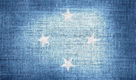 micronesia: Flag of Federated States of Micronesia on burlap fabric Stock Photo