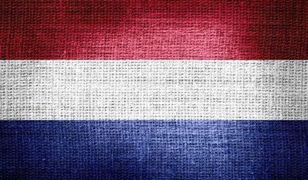 netherlands flag: Netherlands flag on burlap fabric Stock Photo