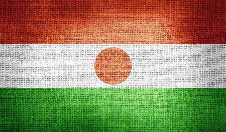 niger: Niger flag on burlap fabric