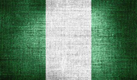 nigeria: Nigeria flag on burlap fabric Stock Photo