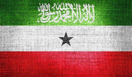 somaliland: Somaliland flag on burlap fabric Stock Photo