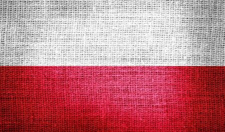 poland flag: Poland flag on burlap fabric Stock Photo