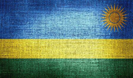 rwanda: Rwanda flag on burlap fabric Stock Photo