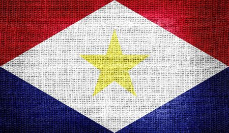 saba: Saba flag on burlap fabric Stock Photo