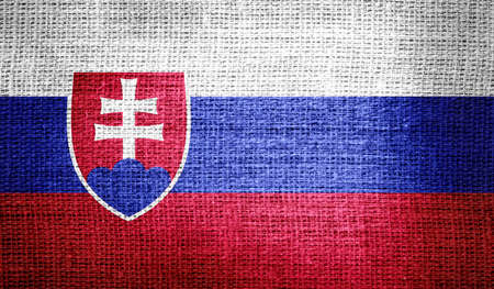 slovakia flag: Slovakia flag on burlap fabric Stock Photo