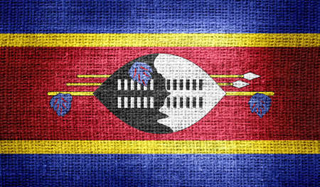 swaziland: Swaziland flag on burlap fabric