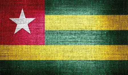 togo: Togo flag on burlap fabric