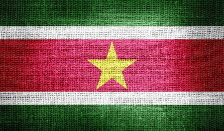 suriname: Suriname flag on burlap fabric