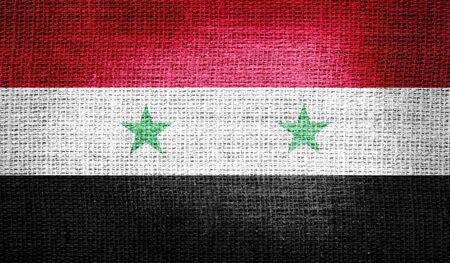 syria: Syria flag on burlap fabric