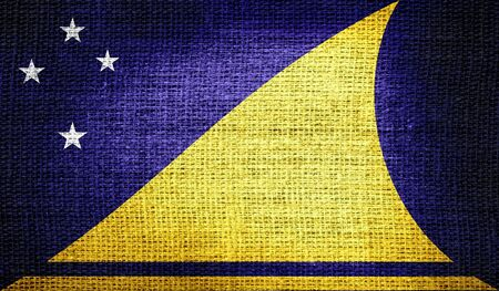 tokelau: Tokelau flag on burlap fabric Stock Photo