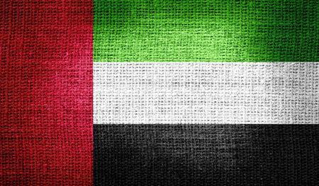 united arab emirates: United Arab Emirates flag on burlap fabric