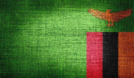 zambia: Zambia flag on burlap fabric Stock Photo