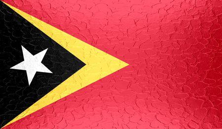 east: East Timor flag on metallic metal texture