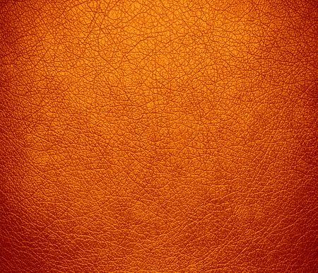 Orange (color wheel) leather texture background photo