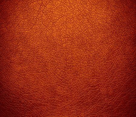 Burnt orange leather texture background photo