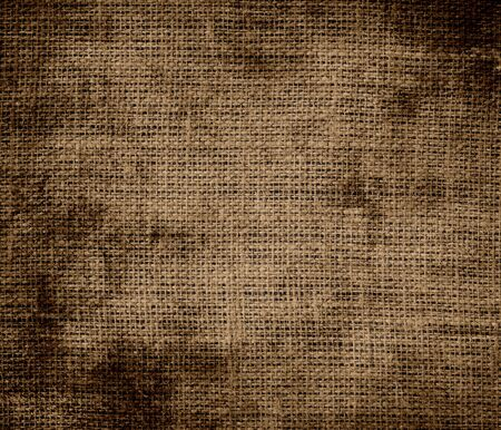 Grunge background of coyote brown burlap texture photo