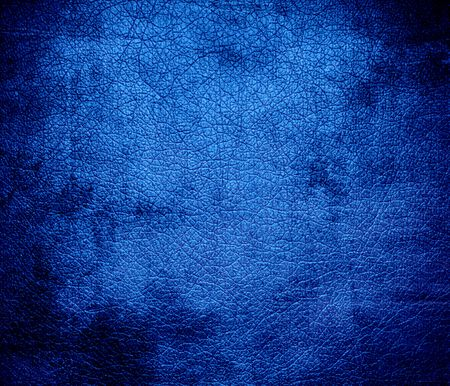 Grunge background of bright navy blue leather texture