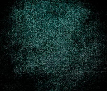 jungle green: Grunge background of deep jungle green leather texture Foto de archivo