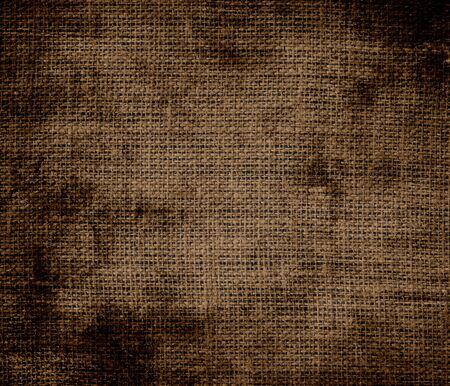 dark brown: Grunge background of dark brown burlap texture