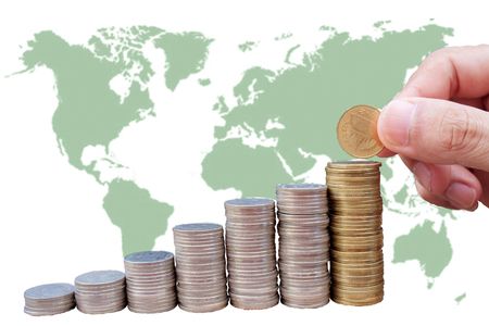 hand put coin on stacks or graph with Map background photo