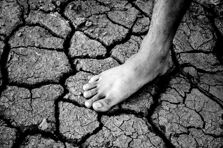 foot on dry or drought land background Stock Photo
