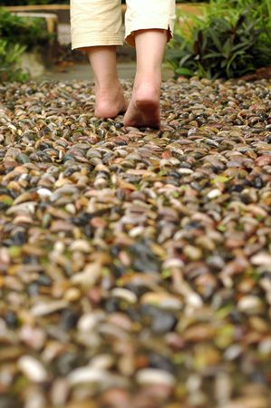A foot reflexology path at garden,shallow focus on foot and stone.