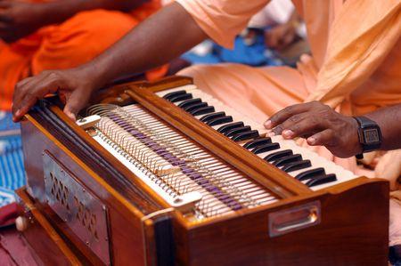 chanting: Krishna Devotee Playing Harmonium