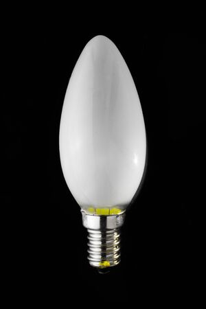 the screw candle light bulb isolated on black background